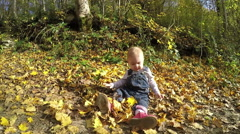 Little girl playing in the autumn park. Full HD video Stock Footage