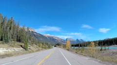 POV road trip driving by river Icefields Parkway in Canada Stock Footage