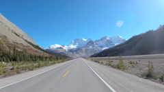 POV driving by mountain river on Highway 93 Canada Stock Footage