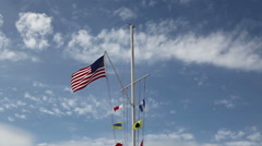 US Flag On Nautical Flagpole With Clouds Sped Up Stock Footage