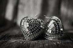 Shiny Valentine hearts on old wooden background - stock photo