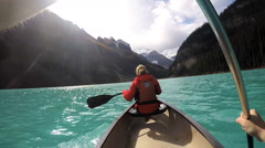 View of people Kayaking Lake Louise Alberta Canada Stock Footage