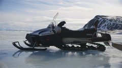 Ski-doo parked in the middle of frozen Arctic sea. Stock Footage