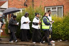 LONDON - MARCH 29TH: Unidentified people at a palm sunday procession on March Stock Photos