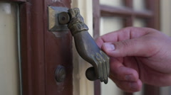 Moorish doorknob in Portugal - knocking - stock footage