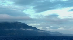 Time lapse of clouds rolling past the Rocky Mountains. Stock Footage