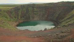 Aerial view Kerid Crater Lake an extinct volcano Iceland Stock Footage
