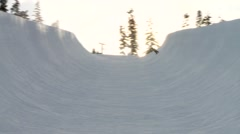 Snowboarder going through the Whistler half-pipe. Stock Footage