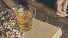 Grandfather after working in the studio tasty drink a glass of beer - stock footage