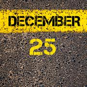 Stock Photo of 25 December calendar day over road marking yellow paint line