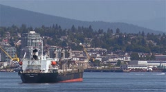 Cargo ship pulling into a British Columbian harbour. Stock Footage