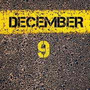 9 December calendar day over road marking yellow paint line Stock Photos