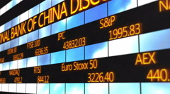 Names of world major stock exchanges, market quotes running on electronic ticker - stock footage