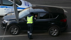 Police in Moscow in the middle of the driver checks a woman in December 2015 Stock Footage