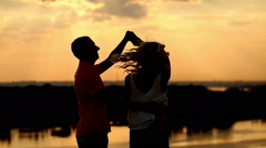 Silhouette in love on sunset. Dance and kisses. - stock footage