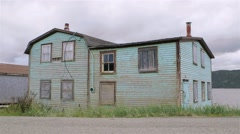 Abandoned house with boarded up windows in Conche, Newfoundland & Labrador. - stock footage