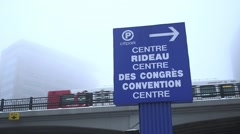 A convention centre sign stands in snowy weather. Stock Footage