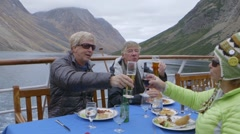 Tourists enjoying a meal on a cruise ship during an expedition. Slow Motion Stock Footage