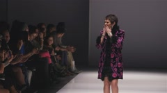 Model walking down the runway at a fashion show. - stock footage