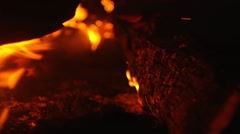Wooden structure burns with sparks at night Stock Footage