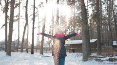 Happy supper exited girl throwing snow in the air on sunny day Stock Footage