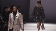 Models walking down the runway at a fashion show. - stock footage