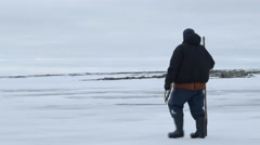 Fisherman testing ice during an arctic expedition. Stock Footage