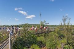 Tourists at Iguazu Falls Devil Throat Argentinian Border Stock Photos