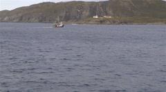 Fishing trawler traveling through the ocean. Slow Motion Stock Footage