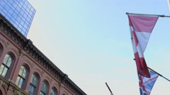 Flags protruding from an old building on Sparks St. Tilt Stock Footage