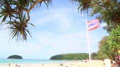 Tourists relax, sunbathe and play on Kata beach, Phuket, Thailand. - stock footage