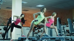 Fitness class doing exercises with dumbbells Stock Footage