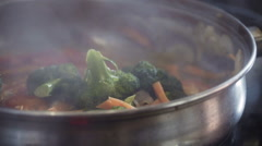 Cooking vegetables in saucepan, close up - stock footage