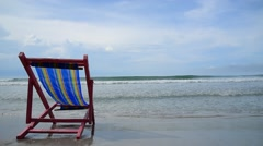 Pink beach chair at the close of the white sand beach on Thai island Stock Footage
