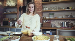 Young woman putting tomato paste on the spaghetti Stock Footage