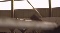 Horseback rider in an indoor arena goes over a small obstacles. Dolly Shot Stock Footage