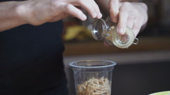 A chef putting spices on the noodles Stock Footage