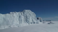 Large iceberg in the Nunavut landscape. Zoom Stock Footage