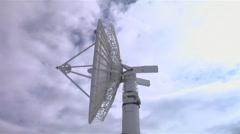 Large white satellite dish rotating 160 degrees. Stock Footage