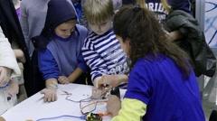 4k Science fair.Children use robotics neuron devices for experiment 3 Stock Footage