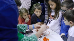 4k Science fair.Children use robotics neuron devices for experiment 2 Stock Footage