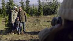 Photographer Takes Family's Portrait At Christmas Tree Farm Stock Footage