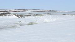 Semi-frozen stream in the Arctic tundra. Stock Footage