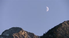 Half-moon above the summits of the Bugaboo Mountains, British Columbia. Stock Footage