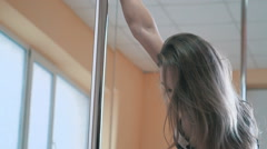 Young sexy woman dancing exotic pole dance, slow motion Stock Footage