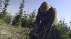 Man Saws Off Extra Branches On His Christmas Tree Stock Footage