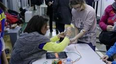 4k Science fair.Children use robotics neuron devices for experiment Stock Footage