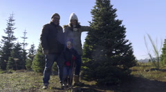 Portrait Of Cute Family Posing With Their Christmas Tree At Christmas Tree Farm Stock Footage