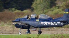 North American T-28C Trojan plane on runway getting ready to take off during in Stock Footage