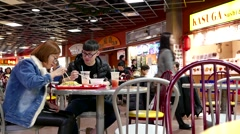 Close up people enjoying meal in mall food court cafeteria. Stock Footage